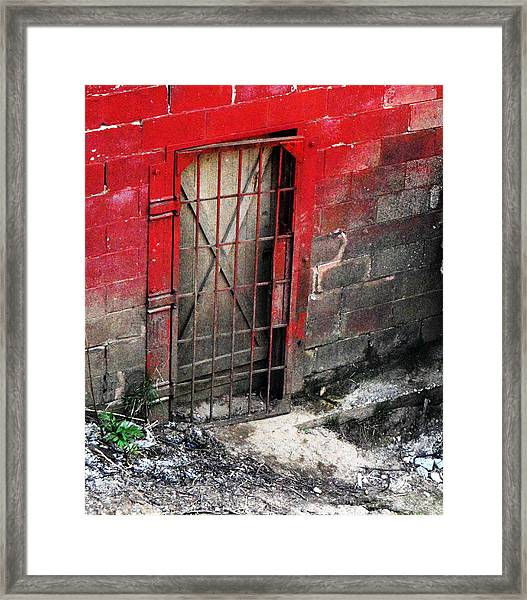 What Lies Behind The Door Framed Print