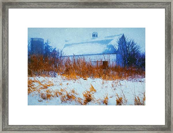 White Barn In Snowstorm Framed Print