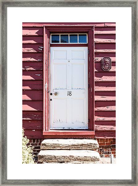 White Door And Peach Wall Framed Print