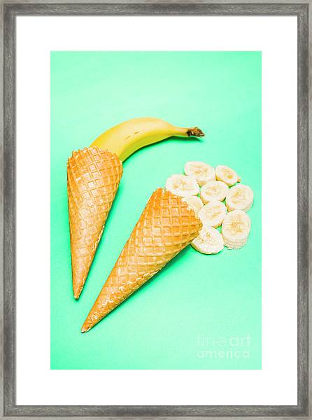 Whole Bannana And Slices Placed In Ice Cream Cone Framed Print