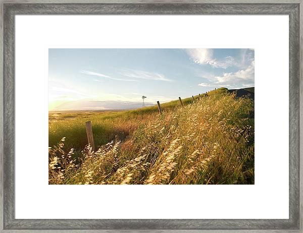 Windmill And The Fence Sundown Framed Print