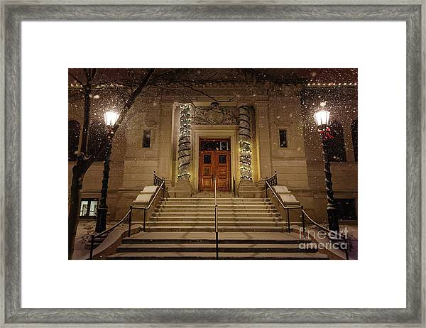 Framed Print featuring the photograph Winona Public Library On A Snowy Night by Kari Yearous