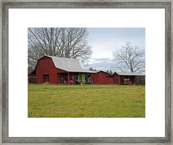 Winter Red Barn Framed Print