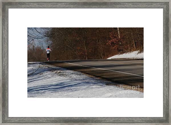 Winter Run Framed Print