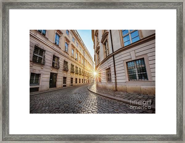 winter sun between two buildings in Vienna Framed Print