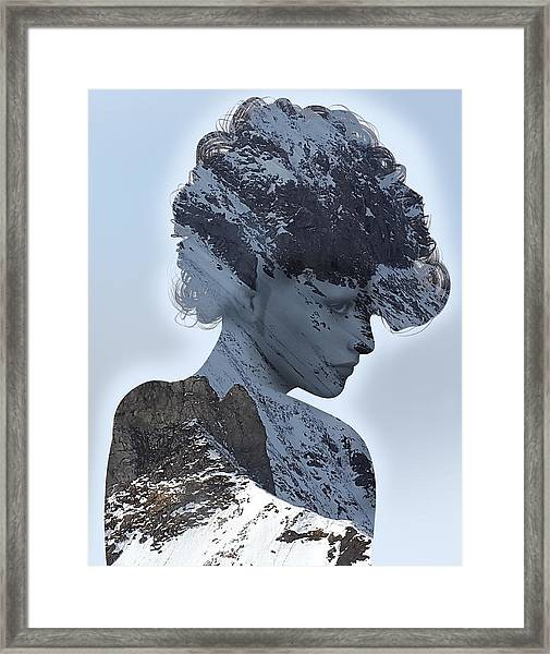 Woman And A Snowy Mountain Framed Print