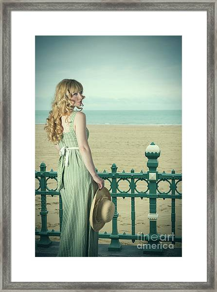 Woman By Railings At The Beach Framed Print