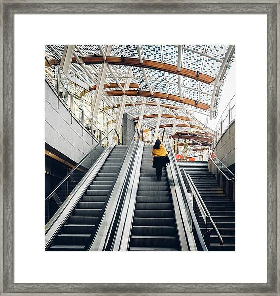 Woman Going Up Escalator In Milan, Italy Framed Print