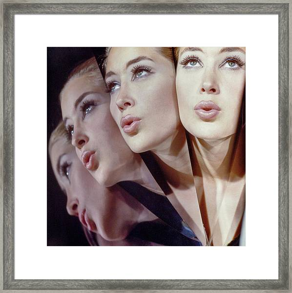 Woman In Four Views Framed Print by John Rawlings