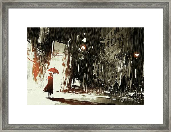 Woman In The Destroyed City Framed Print