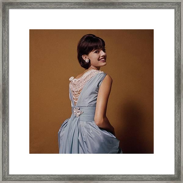 Woman Looks Over Her Shoulder Framed Print by Bert Stern