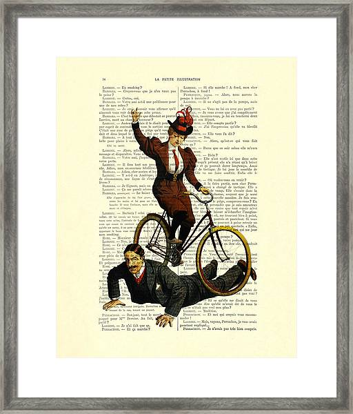 Woman On Bicycle Riding Over Man Framed Print