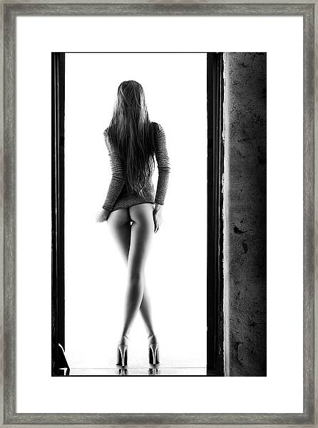 Woman Standing In Doorway Framed Print
