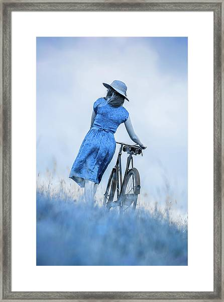 Woman With Bicycle In Field Framed Print