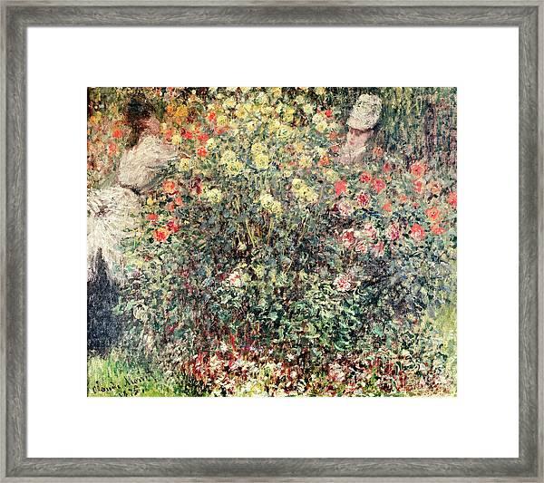 Women In The Flowers Framed Print