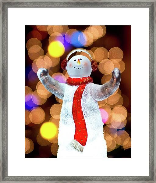 Worshiping Snowman Framed Print