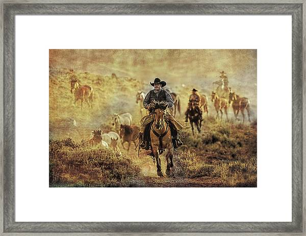 A Dusty Wyoming Wrangle Framed Print