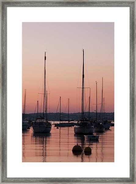 Yachts At Sunset Framed Print