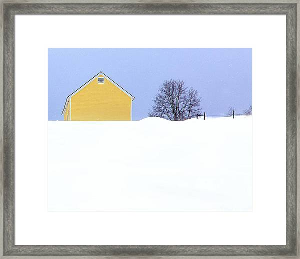 Yellow Barn In Snow Framed Print
