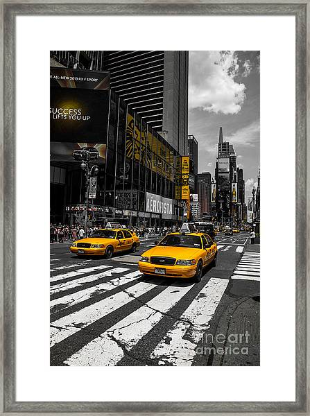Yellow Cabs Cruisin On The Times Square  Framed Print