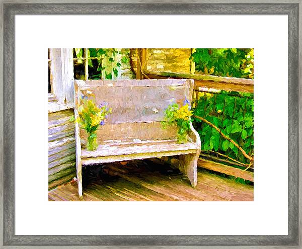Yellow Flowers On Porch Bench Framed Print