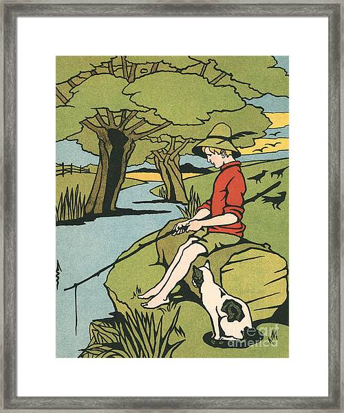 Young Boy Sitting On A Log Fishing In A Small River In The Country With His Cat Framed Print