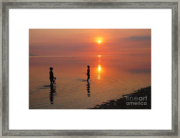 Young Fishermen At Sunset Framed Print