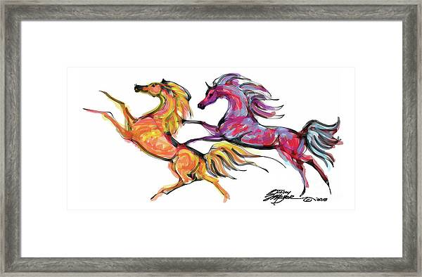 Young Horses Playing Framed Print