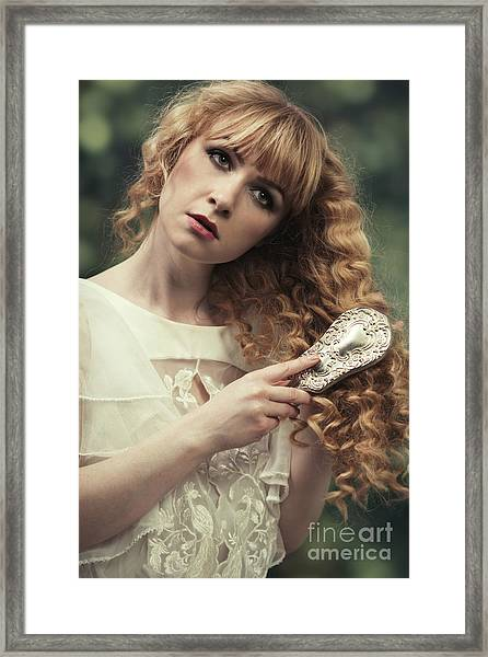 Young Woman Brushing Her Hair Framed Print