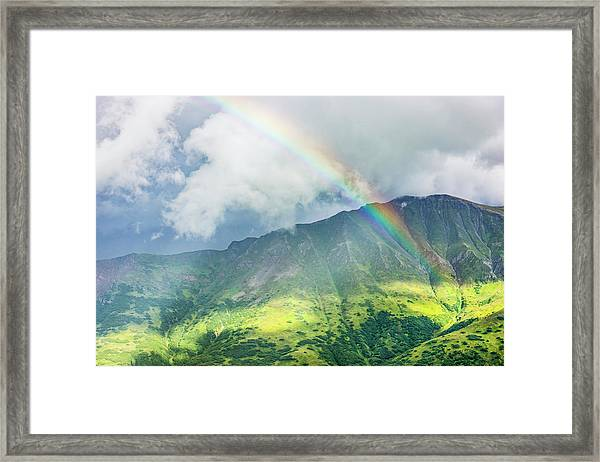A Rainbow Shines Through Atmospheric Framed Print by Kevin G. Smith