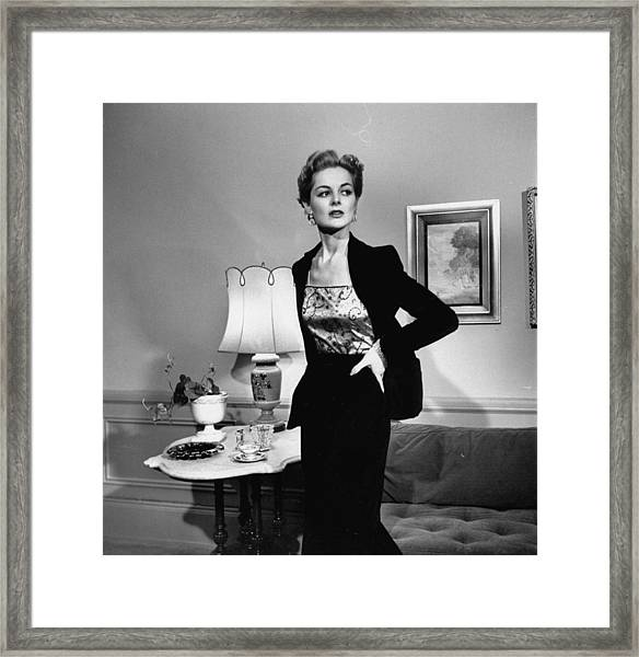 A Woman Wearing The Visible Half Of A Sl Framed Print by Nina Leen