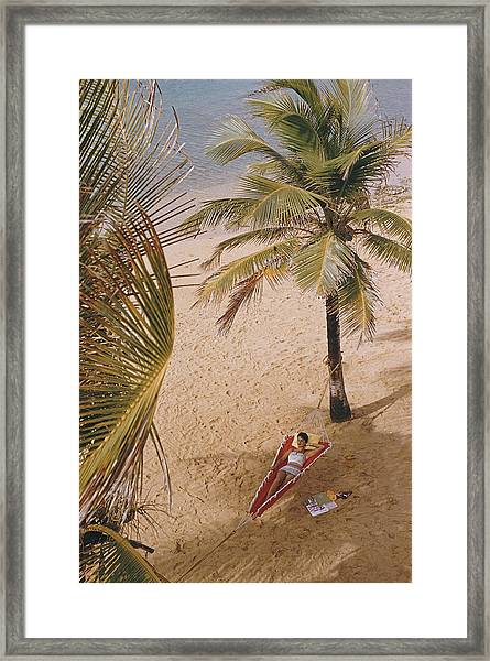 Caribe Hilton Beach Framed Print by Slim Aarons