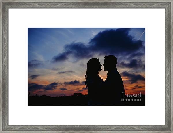 Couple With Cloud Sky Backlight Framed Print