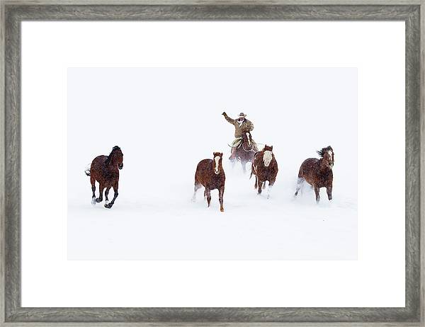 Cowboys And Horses In Winter Framed Print