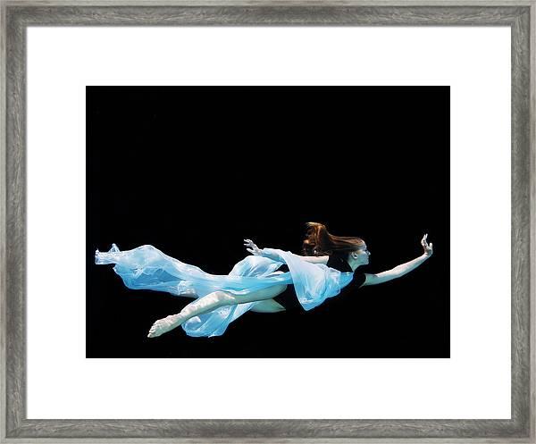 Female Dancer Underwater Against Black Framed Print