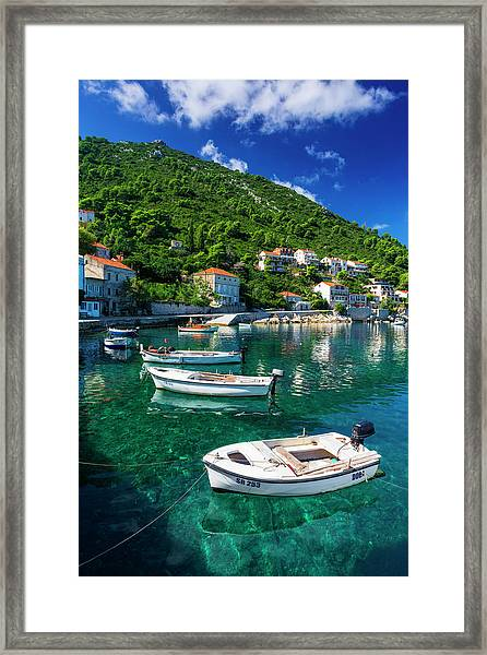 Fishing Boats And Blue Waters Framed Print by Russ Bishop