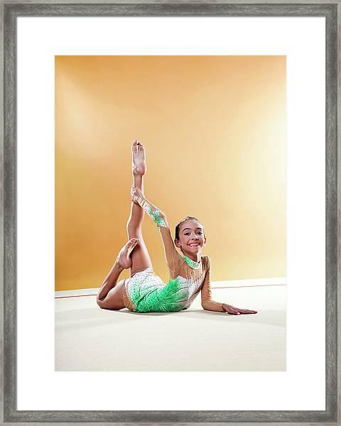 Gymnast, Smiling, Bending Backwards Framed Print by Emma Innocenti