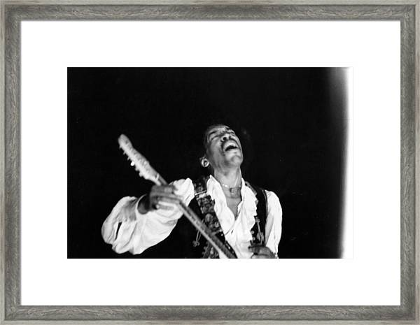 Jimi Hendrix Performs At Monterey Framed Print by Michael Ochs Archives