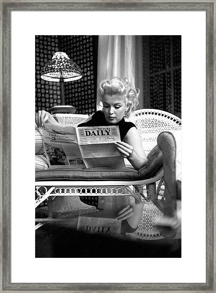 Marilyn Relaxes In A Hotel Room Framed Print