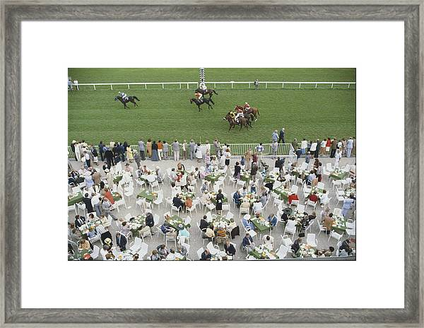 Racing At Baden-baden Framed Print by Slim Aarons