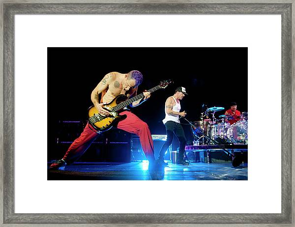 Red Hot Chili Peppers Perform At O2 Framed Print by Neil Lupin