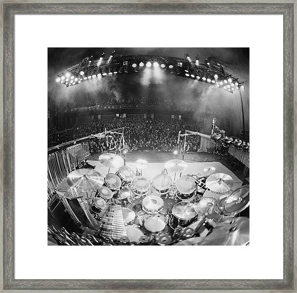 Rush In Concert Framed Print by Fin Costello