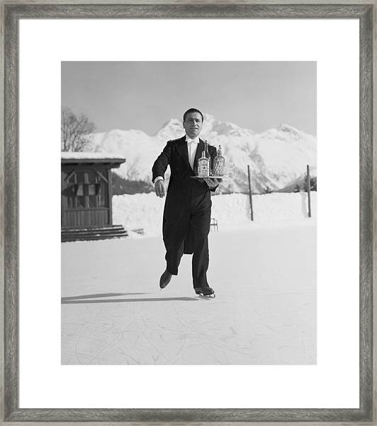 Skating Waiter Framed Print