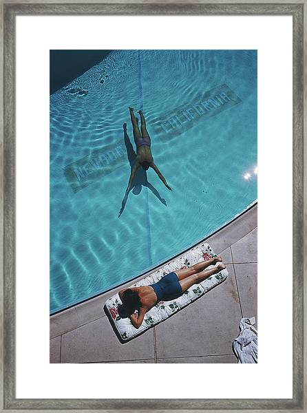 Swimmer And Sunbather Framed Print