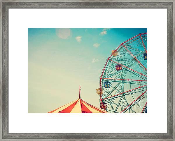Vintage Colorful Ferris Wheel Over Blue Framed Print