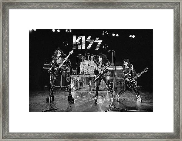 Kiss Alive Framed Print