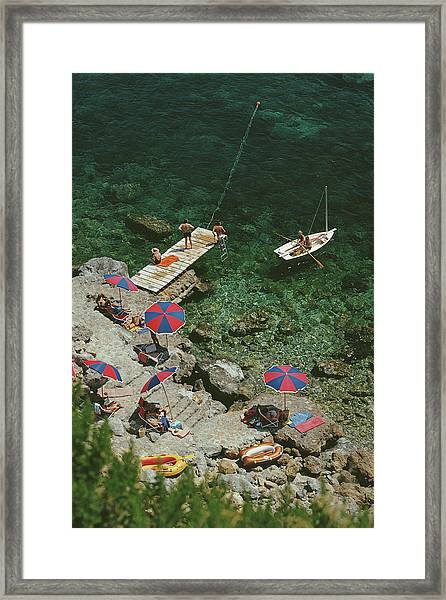 Porto Ercole Framed Print by Slim Aarons