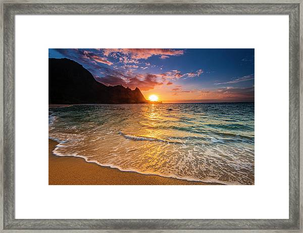 Sunset Over The Na Pali Coast Framed Print by Russ Bishop