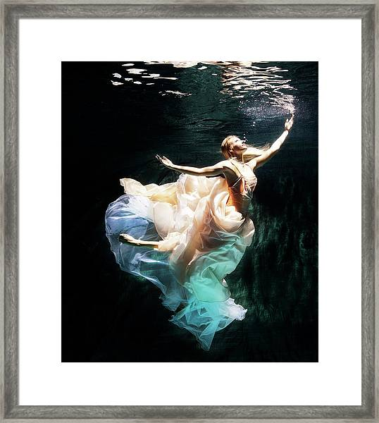 Female Dancer Performing Under Water Framed Print by Henrik Sorensen