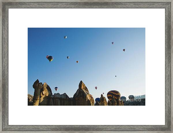 Colorful Balloons Flying Over Mountains And With Blue Sky Framed Print